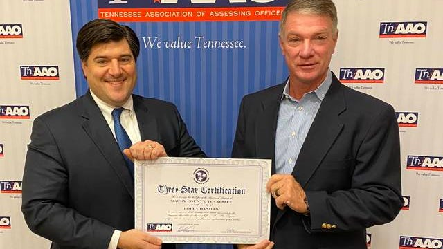 Maury County Assessor of Property Bobby Daniels is presented with a Three Star Certification from the Tennessee Association of Assessing Officers by Executive Director Will Denami.
