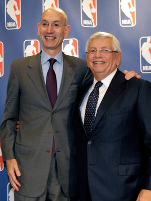 Then-NBA deputy commissioner Adam Silver, left, poses for a photograph with then-commissioner David Stern during a basketball news conference following Board of Governors meetings in New York, Thursday, Oct. 25, 2012.
