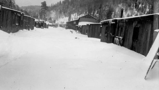 Marcia covered in heavy snow, near the headwaters of the Penasco River during its heyday of logging.