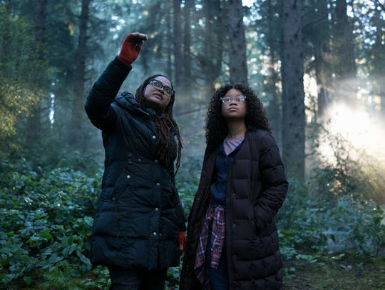 Director Ava DuVernay (left) works with star Storm Reid, who goes searching the galaxy for her father (Chris Pine) in 'A Wrinkle in Time.'