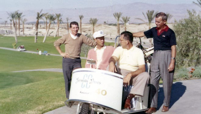 In this file photo, unidentified golfers can be seen conversing at Bermuda Dunes Country Club.