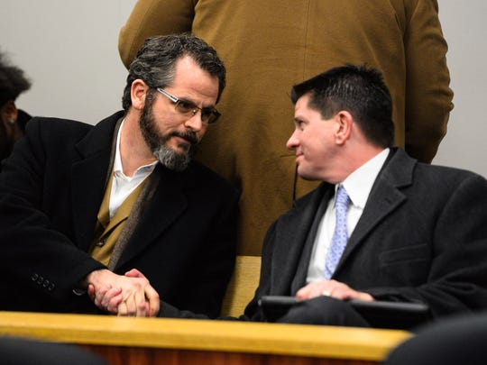 Former State Rep. Todd Courser talks with a member of the gallery Tuesday, March 1, 2016 as he waits for a hearing in Judge Hugh Clarke Jr.'s courtroom.