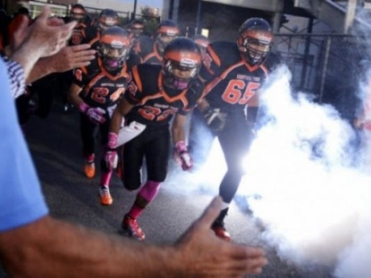 Central York players take the field before their football game against Spring Grove. Central York won, 27-26. (DAILY RECORD/SUNDAY NEWS - KATE PENN)