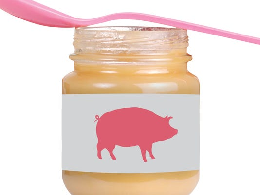 baby jar with apple sauce and pink spoon