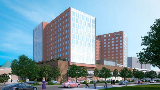 A rendering of the 13-story hotel and apartment complex proposed on Grand River Avenue and Abbot Road looking east.