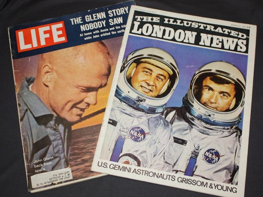 Vintage publications such as a Life magazine from 1962 concerning the first American to orbit the Earth, John Glenn.