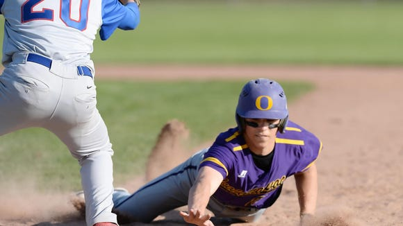 Oconomowoc's Sean Meyer dives back into first base to avoid the pick off attempt during Oconomowoc's victory over Wisconsin Lutheran in 2016.