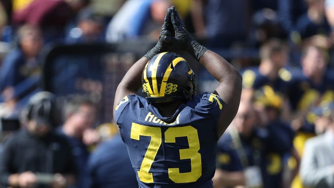 Michigan's Maurice Hurst signals for a safety in the fourth quarter against Cincinnati on Sept. 9, 2017 at Michigan Stadium.
