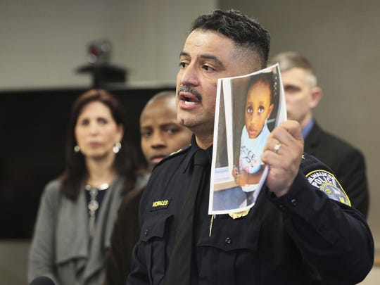 In this Friday, March 15, 2019, photo, Milwaukee Police Chief Alfonso Morales holds a photo of 2-year-old Noelani Robinson as he speaks at a news conference at the Police Administration Building in Milwaukee.