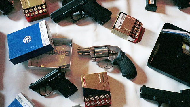 The city of Gary, Ind., sued six local gun stores Aug. 27, 1999, after policemen posing as gang members and juveniles were able to buy handguns, some of which are shown in this photo, using permits in the names of others.