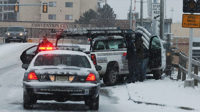 Two vehicles crashed about 8 a.m. Wednesday on the Main Street bridge due to slippery conditions during a light snowfall. No one was injured in the crash.