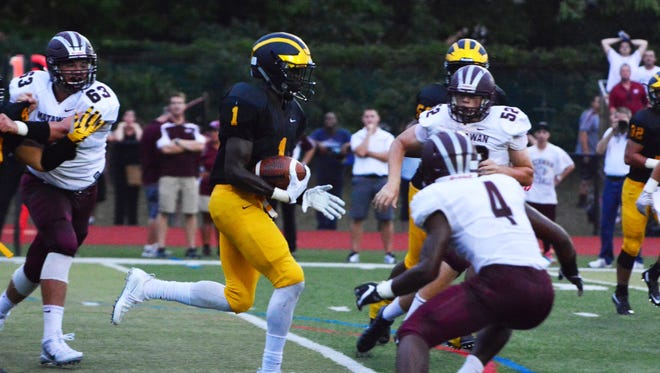 (SPORTS)          09/09/16          Holmdel, NJ St. John Vianney's Chris Chukwuneke (1) runs the ball against Matawan on Friday night in Holmdel. Frank Galipo/ Correspondent ASB 0910 SJ Vianney O