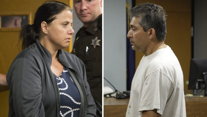 Valbona Lucaj, left, and her husband, Sebastiano Quagliata, are charged with second-degree murder in a Lapeer, Mich., courtroom Aug. 1,  2014.