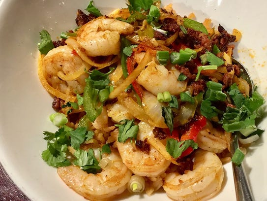 Mexican paella with shrimp on the menu at Cicada Cantina.