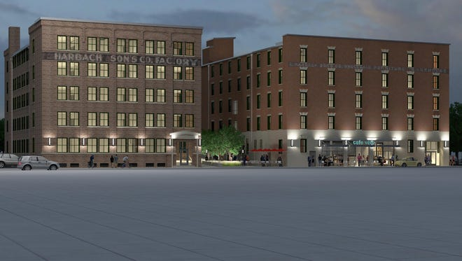The former Harbach Furniture buildings on the south side of downtown are scheduled to be renovated into apartments. The southern building, left, has been home to the artist studio Art316, which will close at the end of the month.