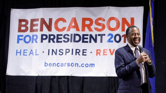 Ben Carson smiles as he is introduced during a town hall meeting on Feb. 21, 2016, in Reno, Nev.