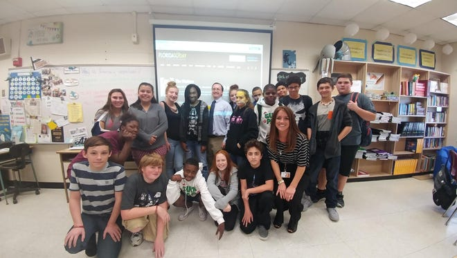 Sharing Literacy Day with Dominique Kidd, front row right, and one of her seventh grade language arts classes at Madison Middle School in Titusville.