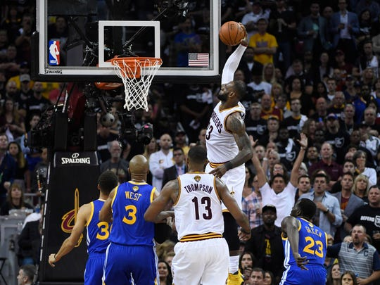 LeBron James dunks against the Golden State Warriors