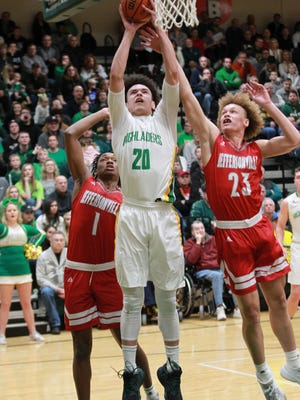Floyd  Central High School's  Cobie Barnes (20) fights pressure from Jeffersonville High School's Tre Coleman (1) and Ezekiel Smith (23) during the first half of play at Floyd Central High School in Floyd Knobs, Indiana. Jan. 16,  2018.