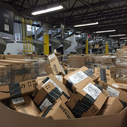 Piles of packages waiting for shipment at Amazon's