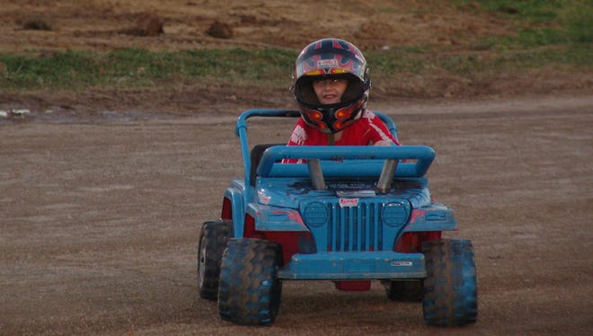 Jett Lindell, 5, makes his way down the track during the power wheel class of the Smash It demolition derby Monday at the Coshocton County Fair.