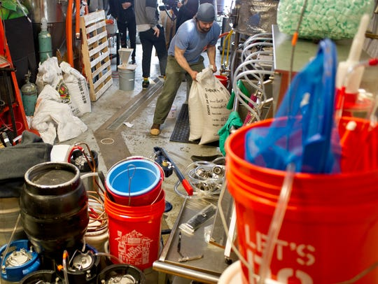 Brewer Brian Eckert gathers all the ingredients he