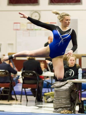 Nicolet junior Cailin Mahoney competes in the floor exercise during the WIAA sectional gymnastics tournament on Saturday, Feb. 25, 2017 at Menomonee Falls. She advanced to state on the uneven bars.