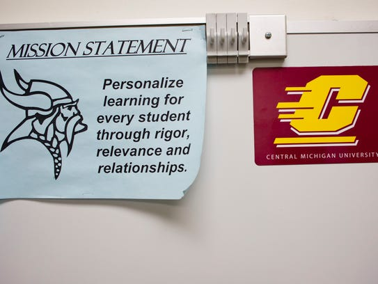 A sign for Central Michigan University is displayed