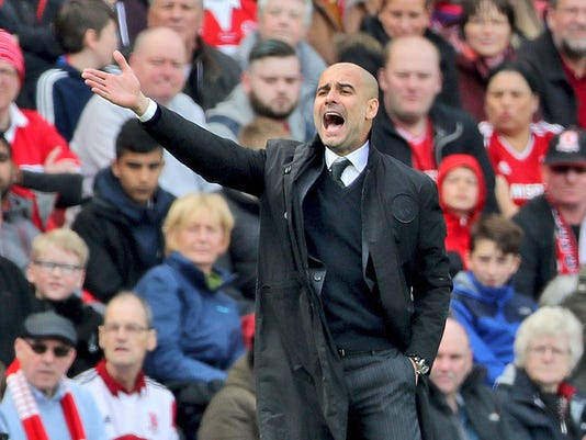 Manchester City manager Pep Guardiola gestures from the touchline during their match against Middlesbrough during their English Premier League soccer match at the Riverside Stadium in Middlesbrough, England, Sunday April 30, 2017. (Owen Humphreys/PA via AP)