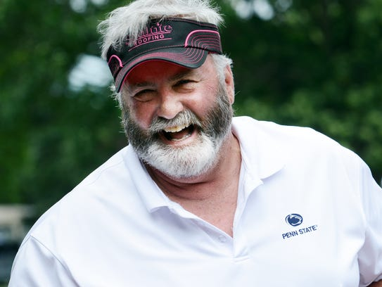 Former Penn State and NFL playert Scott Fitzkee enjoys a laugh at last year's Eddie Khayat and George Tarasovic Celebrity Golf Classic at Out Door Country Club. Fitzkee is a Red Lion High School graduate. Bill Kalina photo
