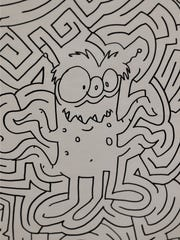 A space creature is incorporated into a maze mural created by artist Joe Wos Tuesday at the Farmington Public Library.