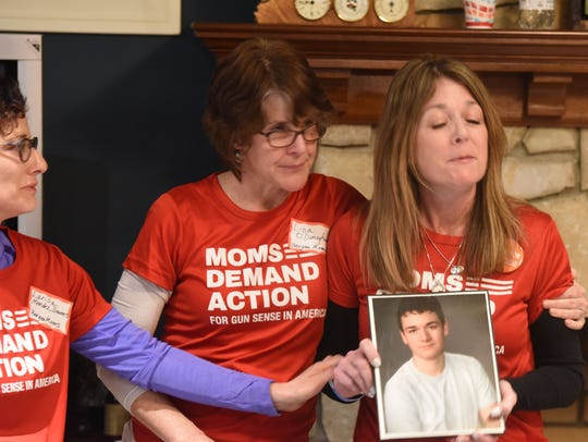 Jennifer Gonzales (right) holds a picture of her son,Jack