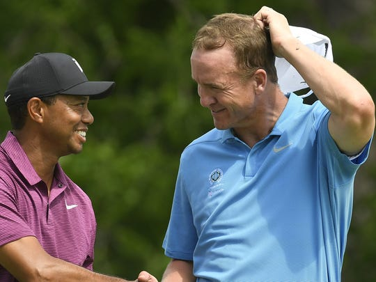 Tiger Woods and Peyton Manning had a fun day at Muirfield Village on Wednesday.