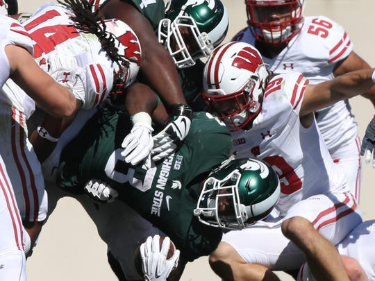 Michigan State RB LJ Scott runs the ball against the Wisconsin Badgers during first half action Saturday, September 24, 2016 at Spartan Stadium in East Lansing.