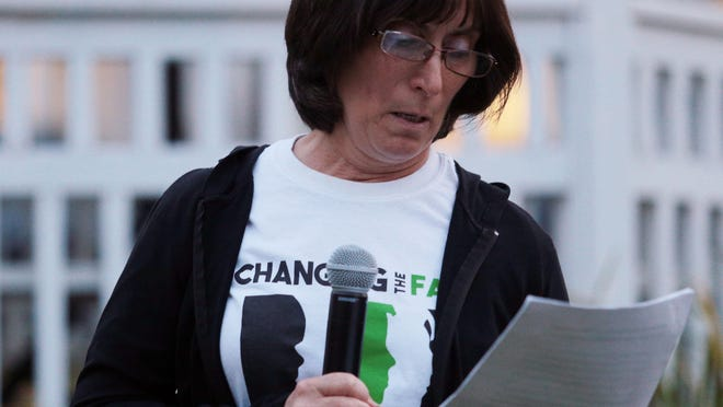 """Mary Burns speaks during a vigil in honor of International Overdose Awareness Day presented by the Center for Prevention and Counseling Thursday, August 31, 2017. Burns recently published a memoir """"Saving Eric"""" detailing her son Eric's struggle with addiction that led to his death in 2012."""