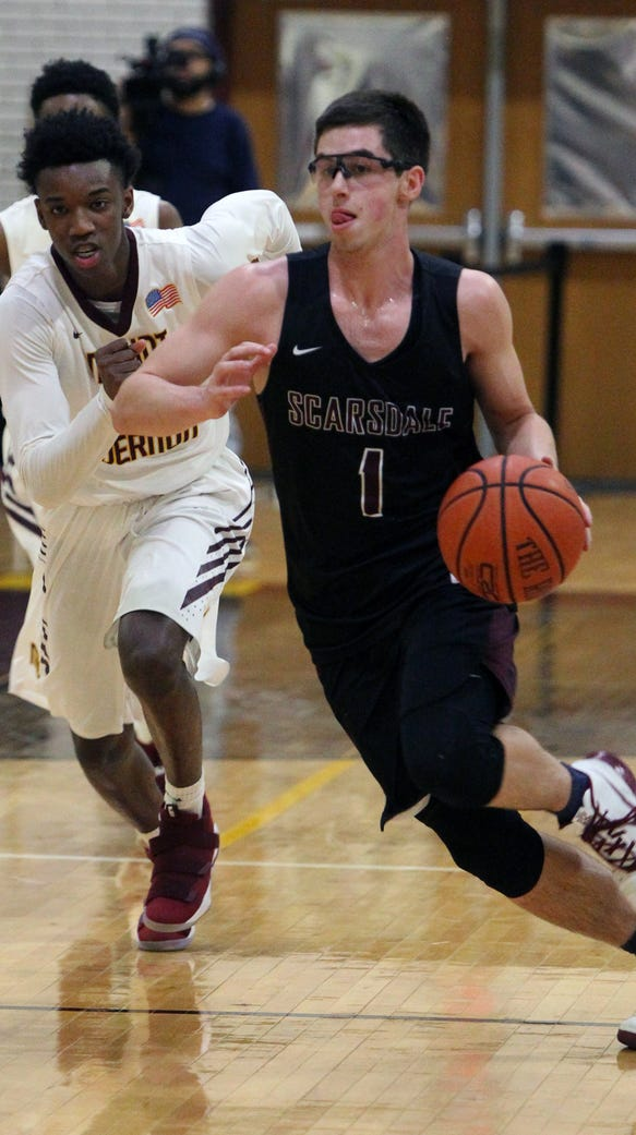 Scarsdale's Nash Goldman brings the ball up court past
