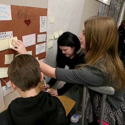 Writings on the wall: Students help solve ugly situation