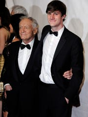 Publisher Hugh Hefner, left, and son Cooper Hefner