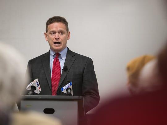 Attorney General Matt Denn gives a presentation at