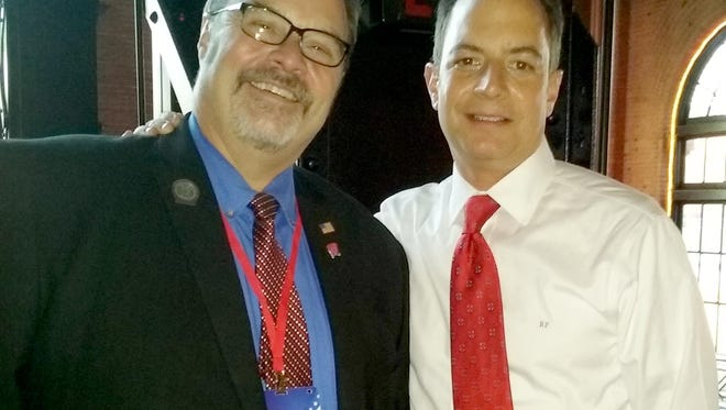 Paul Tittl (left) with Reince Priebus, chairman of the Republican National Committee, at reception honoring Priebus.