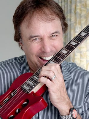Comedian Kevin Nealon rocks out with his Traveler Guitar at home.