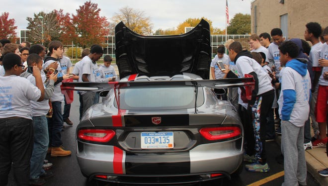 Franklin Middle School students check out the Dodge Viper.