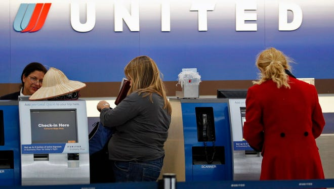 United Airlines service counter at O'Hare International Airport in Chicago.