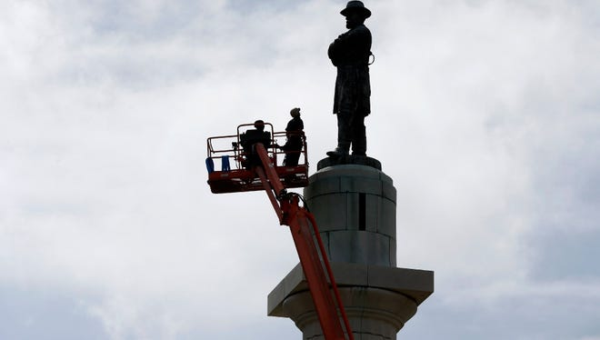 Workers prepare to take down the statue of Robert E. Lee, former general of the Confederacy, in Lee Circle in New Orleans in May.