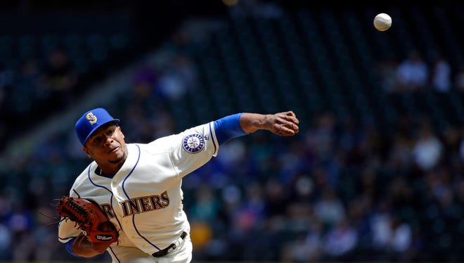 Seattle Mariners starting pitcher Ariel Miranda throws against the Tampa Bay Rays in a baseball game Sunday, June 4, 2017, in Seattle. (AP Photo/Elaine Thompson)