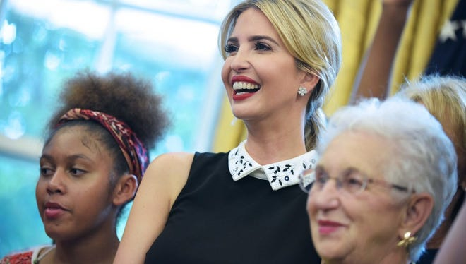 Ivanka Trump smiles during a ceremony before US President Donald Trump signed a memorandum on increasing access to science, technology, engineering and mathematics education in the Oval Office of the White House on September 25, 2017 in Washington, DC.