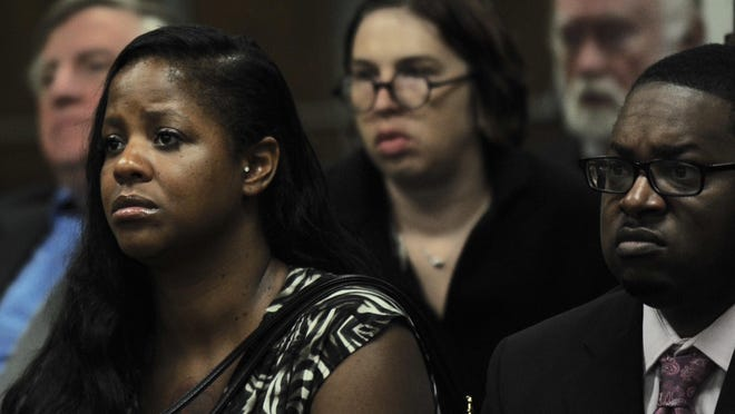 Darlena Savage, left, mother of Victoria Mack, who was killed in a drunken driving accident, listens during Charles Cahill Jr.'s preliminary examination Wednesday at 34th District Court in Romulus.