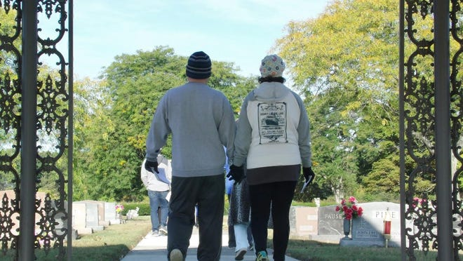 Monroe residents Will and Lindsay Dodd walked at St. Joseph Cemetery in Monroe on Saturday morning in honor of their infant son, Nathan Philip. The memorial walk was held to honor babies who have died due to pregnancy loss or infant death.