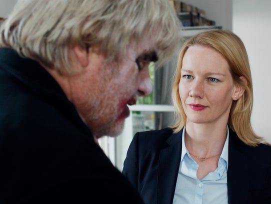 Peter Simonischek as Winfried and Sandra Hüller as