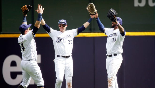 Milwaukee Brewers outfielders Hernan Perez (14), Christian Yelich (22) and Domingo Santana (16) celebrate their victory after the MLB game between the Arizona Diamondbacks and Milwaukee Brewers at Miller Park.